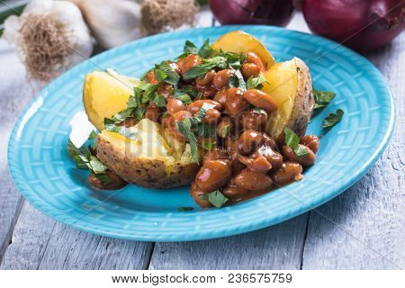 Roasted jacket potato filled with refried kidney beans