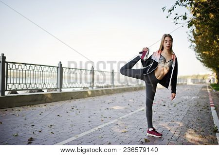 Young Girl Has The Training And Doing Exercise Outdoors. Sport, Fitness, Street Workout Concept.