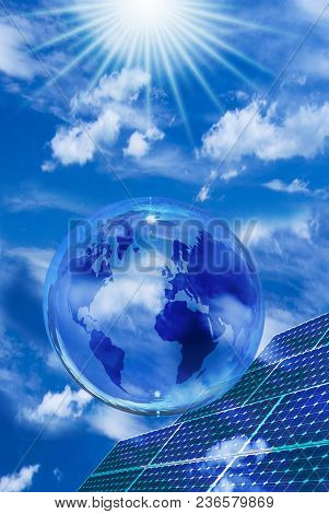 Solar Landscape With Blue Sky. In The Foreground A Transparent Bubble With Globe And Solar Panels