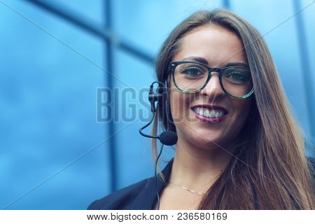Young Woman Representative Talking In A Phone Microphone For Customer Support