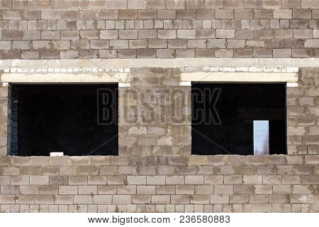 Windows In A Brick House Under Construction As A Background