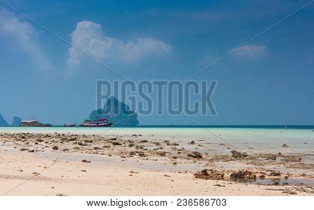 Traditional Thai Longtail Boats On The Beach Of Ko Ngai, Koh Lanta, Thailand.