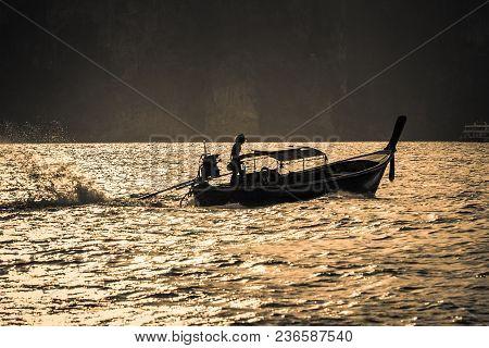Traditional Thai Long Boat In Tonsai Bay At Sunset, Phi Phi Island (koh Phi Phi), Thailand.
