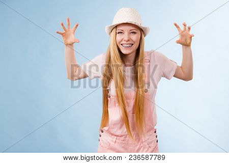 Funny Angry Adorable Teenage Woman Making Silly Faces Being Displeased Wearing Summer Outfit.