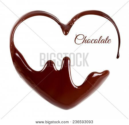 Chocolate in the form of heart. Melted chocolate syrup on white background. Liquid chocolate on a white background.