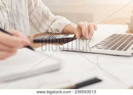 Closeup Of Woman Hands Typing On Laptop And Counting On Calculator. Financial Background, Count And