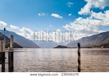 Beautiful View Of Lake Como Italy From Bellagio. Landscape With Marina. On Background Alps Mountains