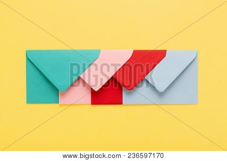 Abstract Background With Colofful Envelopes On Yellow Background. Minimal Styled, Postal Concept.