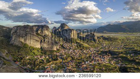 Beautiful Aerial Evening Panorama Of Meteora Rock Pillars And Town Of Kastraki In Central Greece