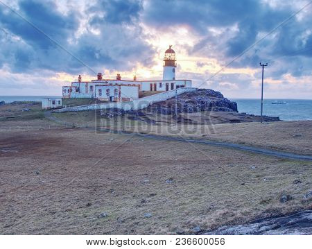 Old Lighthouse On Neist Point. Abandoned  Building With Tower Are Popular Destination Of Travelers.