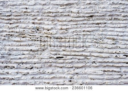Close-up Of Stone Surface With Traces Of Processing. Parallel Lines On The Stone Left By The Cutting
