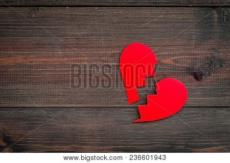 Divorce Concept. Sign Of Divorce. Broken Paper Heart On Dark Wooden Background Top View.