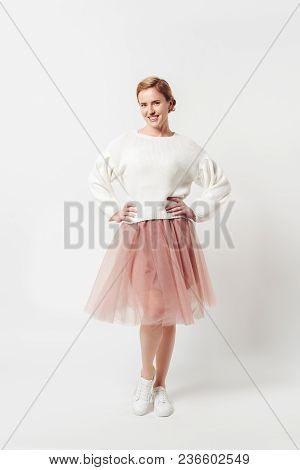 Beautiful Smiling Woman In Pink Tutu Tulle Skirt Looking At Camera Isolated On Grey