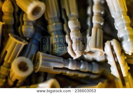 Close Up Plastic Expansion Bolts Or Dowel Pins. Household Toolbox