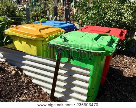 Recycling Bins And Compost Heap In A Community Garden.