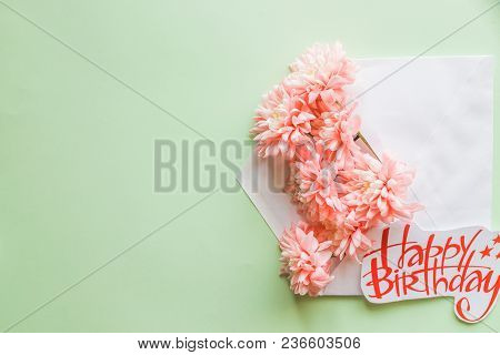 Beautiful Floral Arrangements. Pink Chrysanthemums With Envelope On Background. Flat Lay, Top View.h