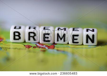 Word Bremen Formed By Alphabet Blocks On Atlas Map Geography