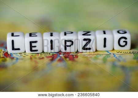 Word Leipzig Formed By Alphabet Blocks On Atlas Map Geography