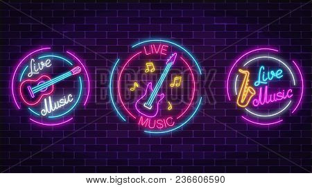 Set Of Neon Live Music Symbols With Circle Frames On Dark Brick Wall Background. Three Live Music Si