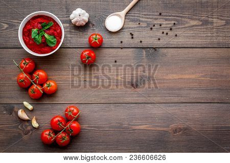 Ingredients For Tomato Sauce. Cherry Tomatoes, Garlic, Green Basil, Black Pepper, Salt In Spoon On D