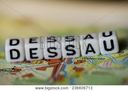 Word Dessau Formed By Alphabet Blocks On Atlas Map Geography