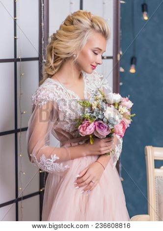 Beauty Fashion Bride In Interior Studio With Bouquet Of Flowers In Her Hands. Beautiful Bride Portra
