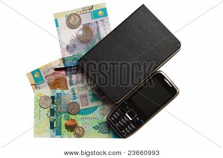 closed notebook and some money of kazakhstan over white with mobile phone