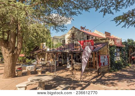 Clarens, South Africa - March 12, 2018: A Street Scene With A Shopping Centre In Clarens In The Free