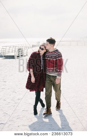 Stylish Young Couple Embracing And Posing On Quay At Winter