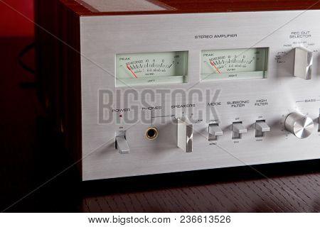 Vintage Stereo Amplifier Metal Frontal Panel with VU meters Closeup