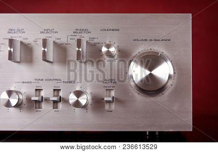 Vintage Stereo Amplifier Metal Frontal Panel Volume Control Knob Closeup