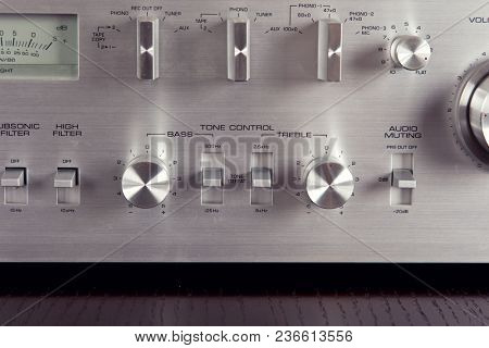 Vintage Stereo Amplifier Frontal Metal Panel with Tone Contril Knobs Closeup