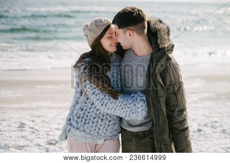 Beautiful Happy Couple Embracing On Winter Sea Shore