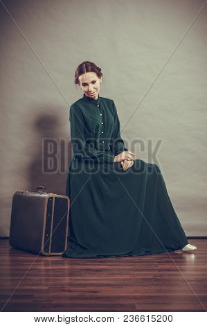 Woman Retro Style Long Dark Green Gown With Old Suitcase, Vintage Photo