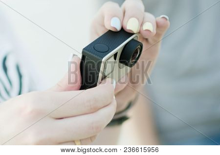 The Woman Is Holding A New Action Camera