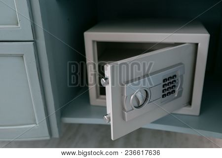 Open Safe In A Wealthy House. Safety Box In Hotel Room. Concept Safe Storage Of Money And Documents.