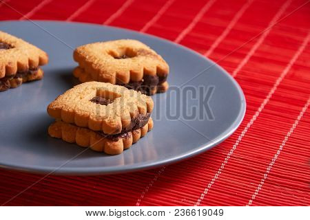 Stacked Chocolate Chip Cookies On Gray Style Plate