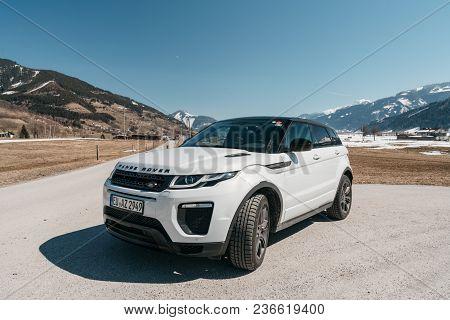 Austria, Alps - March 25, 2018: Latest Brand New White 2018 Range Rover Evoque. Beautiful Car Suv In