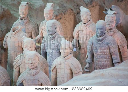 XIAN, CHINA - October 8, 2017: Famous Terracotta Army in Xi'an, China. The mausoleum of Qin Shi Huang, the first Emperor of China is a collection of terracotta sculptures depicting the armored men.