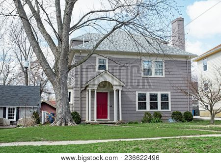 Gray Shake Sided House with Red Door
