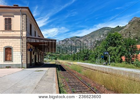 Railroad track runs along platform at local railway station of Tende - small alpine town in France.
