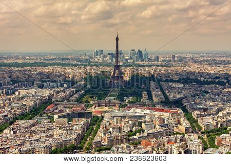 Aerial view of parisian skyline, Eiffel Tower and La Defense district on background as seen from Montparnasse Tower in Paris, France.