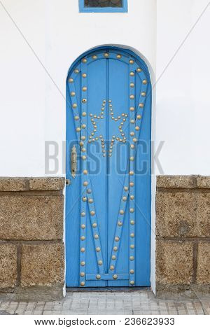 Decorative Blue Door On A Mediterranean Style House