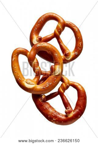 German Soft Pretzel. Three German bread pretzels on a white background.