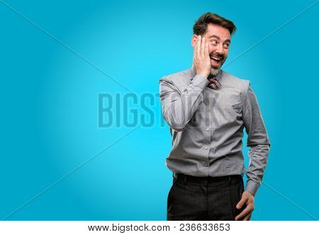 Middle age man, with beard and bow tie so happy and confident showing a big smile surprised finger