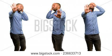 African american man with beard stressful and shy keeping hand on head, tired and frustrated