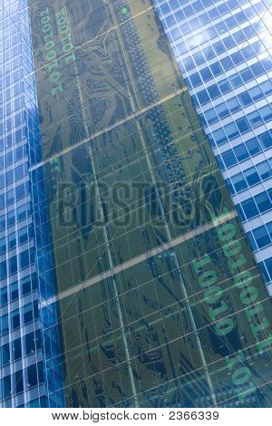 Glass Office Tower With Electronic Circuit Behind Glass