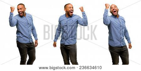 African american man with beard happy and excited expressing winning gesture. Successful and celebrating victory, triumphant