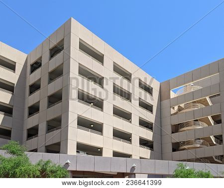 Downtown Multilevel Above Ground Parking Garage With Stair Well On Its Side