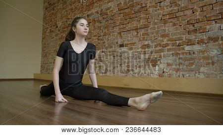 Sport Fitness Lifestyle. Gymnast Training Routine. Flexibility Workout. Young Fit Focused Teenage Gi